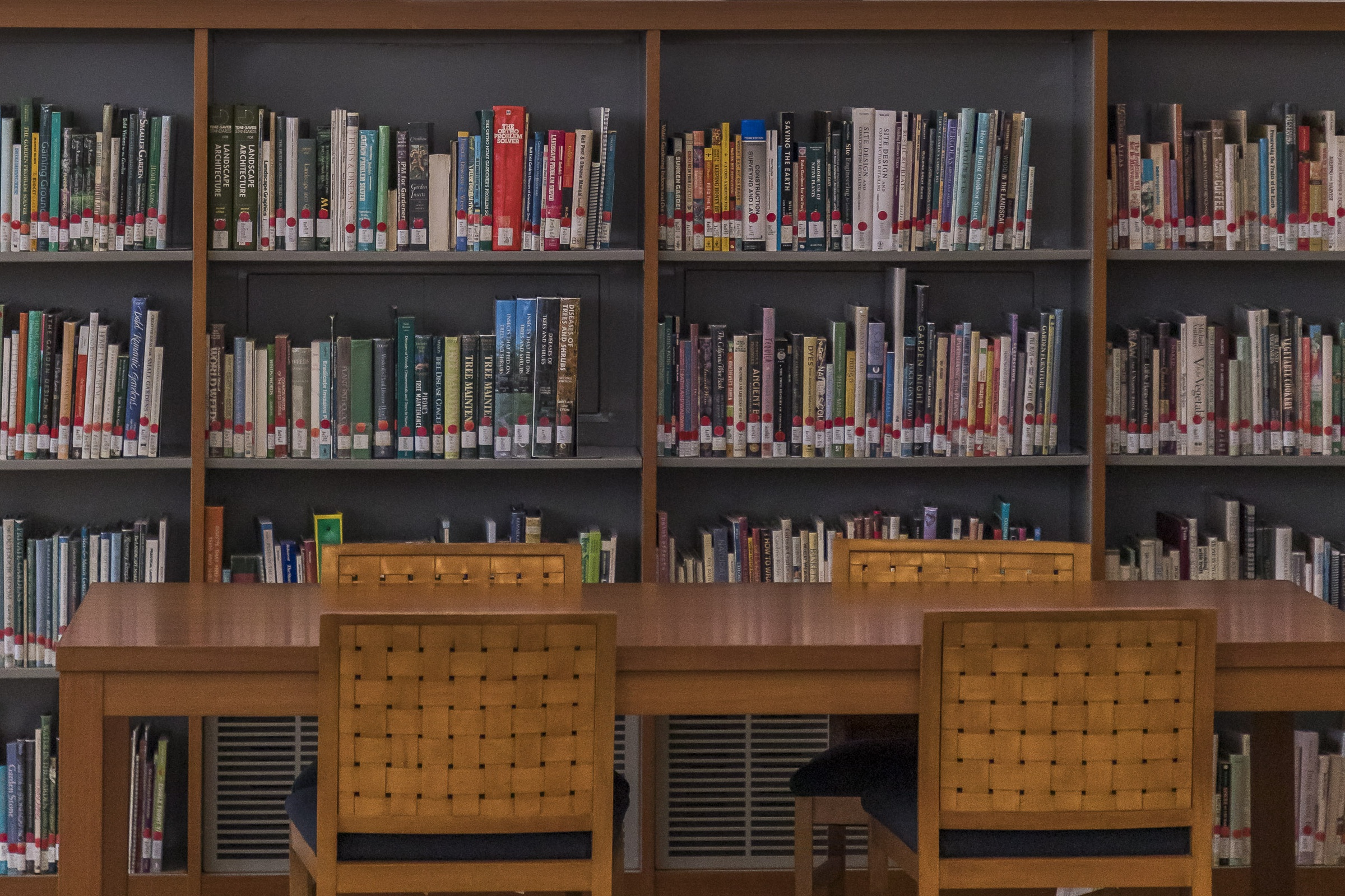 A table in front of bookshelves in the Library